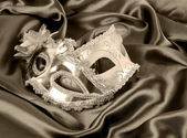 Carnival masks on silk fabric — Stock Photo