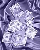 Money and handcuffs on silk fabric, dollars bills — Stock Photo