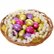Easter eggs, colorful chocolate eggs and pearl necklaces in basket isolated on white background — Stock Photo