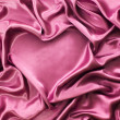 Stock Photo: Heart from red silk drape, background with copy space, Valentine's day