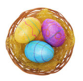 Easter eggs in basket isolated on white background, three glitter colorful eggs — Stock Photo