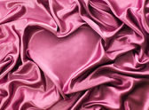 Heart from red silk drape, background with copy space, Valentine's day — Stock Photo