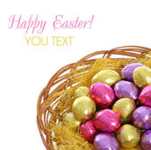 Happy easter, colorful chocolate easter eggs in basket isolated on white background — Stock Photo