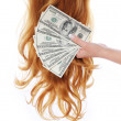 Money and curly brown hair over white background, dollars bills in female hand, hair salon — Stock Photo #22881152