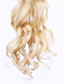 Curly blonde hair over white background — Stock Photo