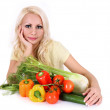 Blonde girl with vegetables on table isolated on white. beautiful young woman on diet. healthy eating — Stock Photo