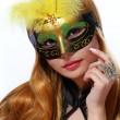 Stock Photo: Girl with carnival mask. beautiful young womwith fashion butterfly ring over white. Halloween. Masquerade.
