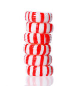 Peppermint candy tower isolated on white. Red striped peppermint Christmas candy, macro. — Stock Photo
