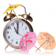 Vacation time concept. Alarm clock and cocktails umbrellas isolated on white background — Stock Photo