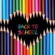 Back to school concept. Colorful pencils arranged as heart on black background. . The words 'Back to School' written in pencil in the heart shape — Stock Photo #29951845
