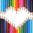 Back to school concept. Colorful pencils arranged as heart.  — Stock Photo