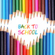Back to school concept. Colorful pencils arranged as heart. The words 'Back to School' written in pencil in the heart shape — Stock Photo