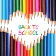 Back to school concept. Colorful pencils arranged as heart. The words 'Back to School' written in pencil in the heart shape — Stock Photo #29951883