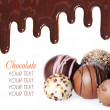 Chocolate candies collection. Beautiful Belgian truffles and chocolate streams isolated on white background — Stock Photo