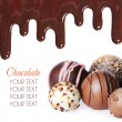 Stock Photo: Chocolate candies collection. Beautiful Belgitruffles and chocolate streams isolated on white background