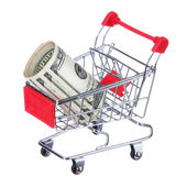 Money roll in shopping cart isolated on white. Dollar bills in trolley. Concept — Stock Photo