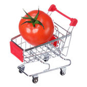Tomato in shopping cart isolated on white — Stock Photo