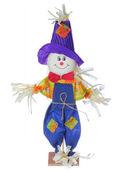 Ler Fågelskrämman i färgglada kläder isolerad på vit bakgrund. Halloween bild. — Stockfoto