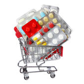 Colorful pills in shopping cart isolated on white background. concept — Stock Photo