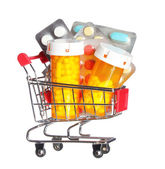 Pill bottle and pills in shopping cart isolated on white. Concept. Pharmacy — Stock Photo