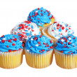 Cupcakes with blue and white cream on the top. patriotic decorated, isolated on white background — Stock Photo