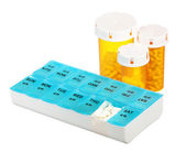 Pill bottles and medicine dose box isolated on white background. Weekly dosage of medication in pill dispenser and three pill bottles — Stock Photo