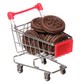 Oreo. Chocolate cookies in shopping cart isolated on white. concept. — Stock Photo