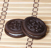 Oreo. Chocolate cookies with cream filling on bamboo mat. — Stock Photo