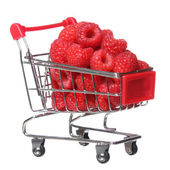 Ripe raspberries in shopping cart isolated on white. concept. — Stock Photo