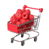 Ripe raspberries in shopping cart isolated on white. concept. — Foto de Stock
