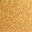 Stock Photo: Bokeh. Christmas gold blinking background