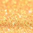 Stock Photo: Bokeh and Stars. Christmas gold blinking background