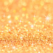 Bokeh and Stars. Christmas gold blinking background — Stock Photo
