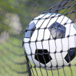 Stock Photo: Soccer ball in goal net. Football. Victory