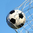 Soccer ball in goal net over blue sky. Football. Victory — Stock Photo