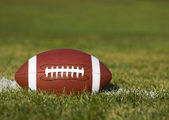 American Football on the field with yard line and green grass. — Stock Photo