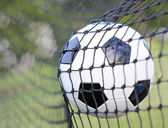 Soccer ball in goal net. Football. Victory — Stock Photo