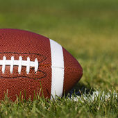American Football on the field with yard line and green grass. Closeup — Stock Photo