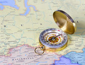 Gold compass on map of Russia — Stock Photo
