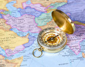 Gold compass on map of Asia — Stock Photo