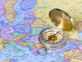 Gold compass on map of Europe — Stock Photo