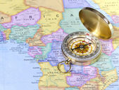 Gold compass on map of Africa — Stock Photo