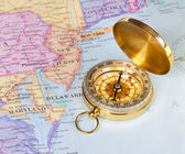 Gold compass on map of United States — Stock Photo
