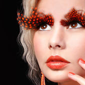Fashion Blonde Model with Long Orange Eyelashes. Professional Makeup for Halloween. Portrait — Stock Photo