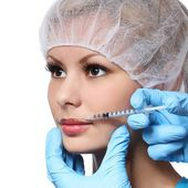 Botox injection in beautiful female face isolated on white. Lips zone. Closeup — Stock Photo