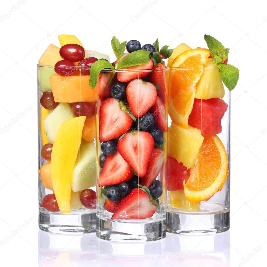 Download - Fruit cocktails isolated on white. Fresh pieces of fruit in ...