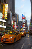Times Square with animated LED signs and yellow cabs, Manhattan, New York City. USA, — Stock Photo