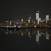 Manhattan at night, New York City skyline with reflection in Hudson River. Panorama — Stock Photo