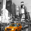 Times Square with yellow cab, Manhattan, New York City. Black a — ストック写真