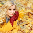 Autumn Girl. Fashion Blonde Beautiful Woman with Maple leaves in — Stok fotoğraf